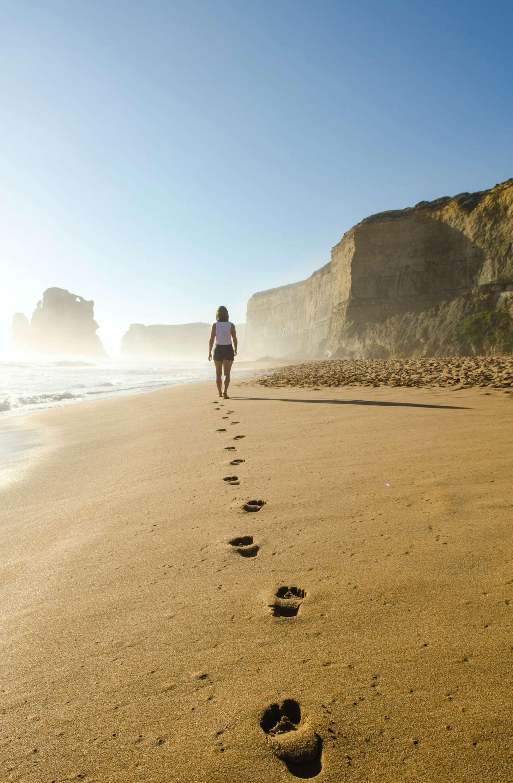 Woman doing walking meditation on a contemplative beach